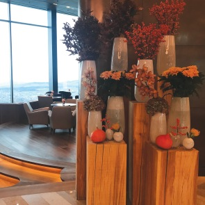 Creative flower arrangements dress up the lobby in warm autumn hues
